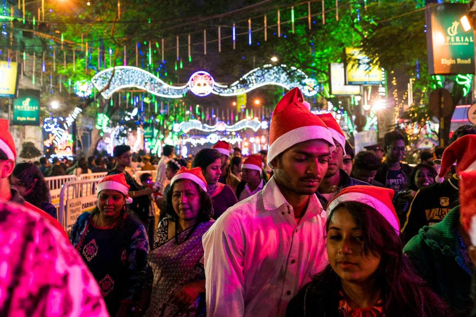 Christmas in Kolkata, India - Pedestrians in Santa Claus hats on Park Street on Christmas Eve - Lost With Purpose travel blog
