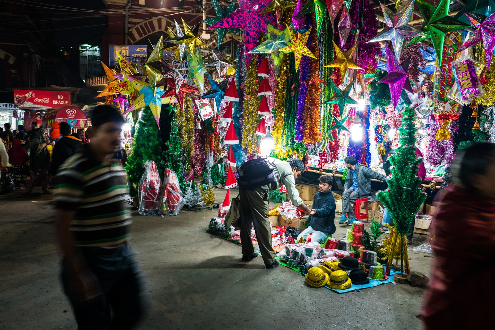 Christmas in Kolkata, India - Man selling Christmas decorations in New Market - Lost With Purpose Travel Blog