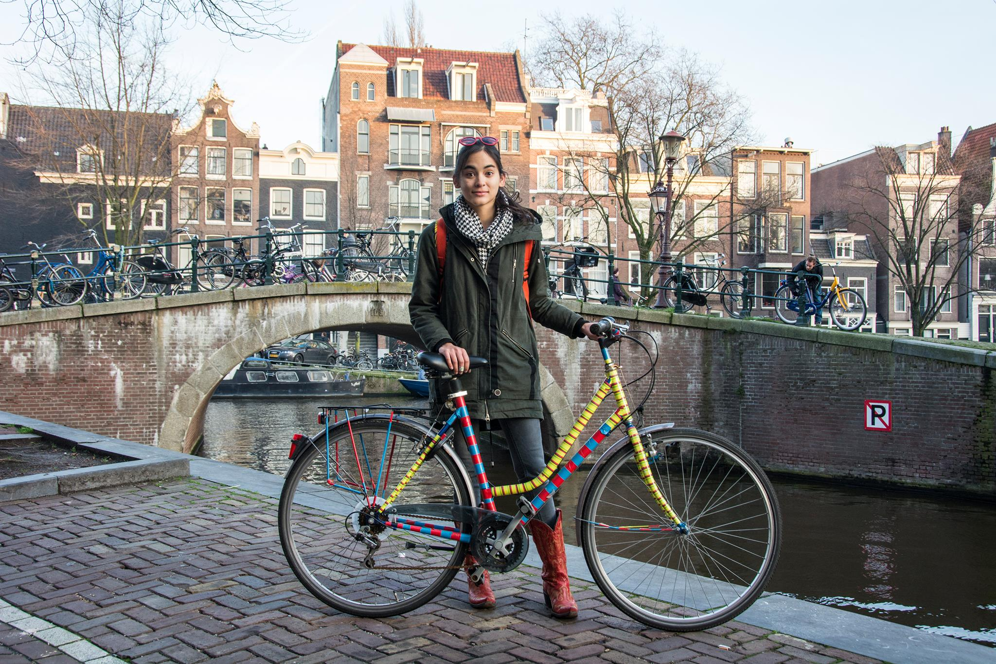 About Lost With Purpose travel blog - Alex with bike in Amsterdam, Netherlands
