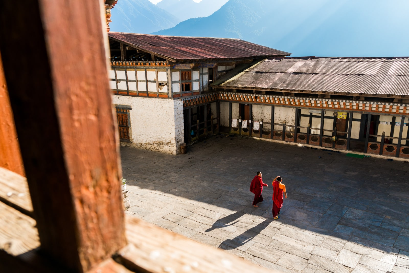Where to go off the beaten track in Bhutan - Monks walking in Kuengarabten palace - Lost With Purpose travel blog