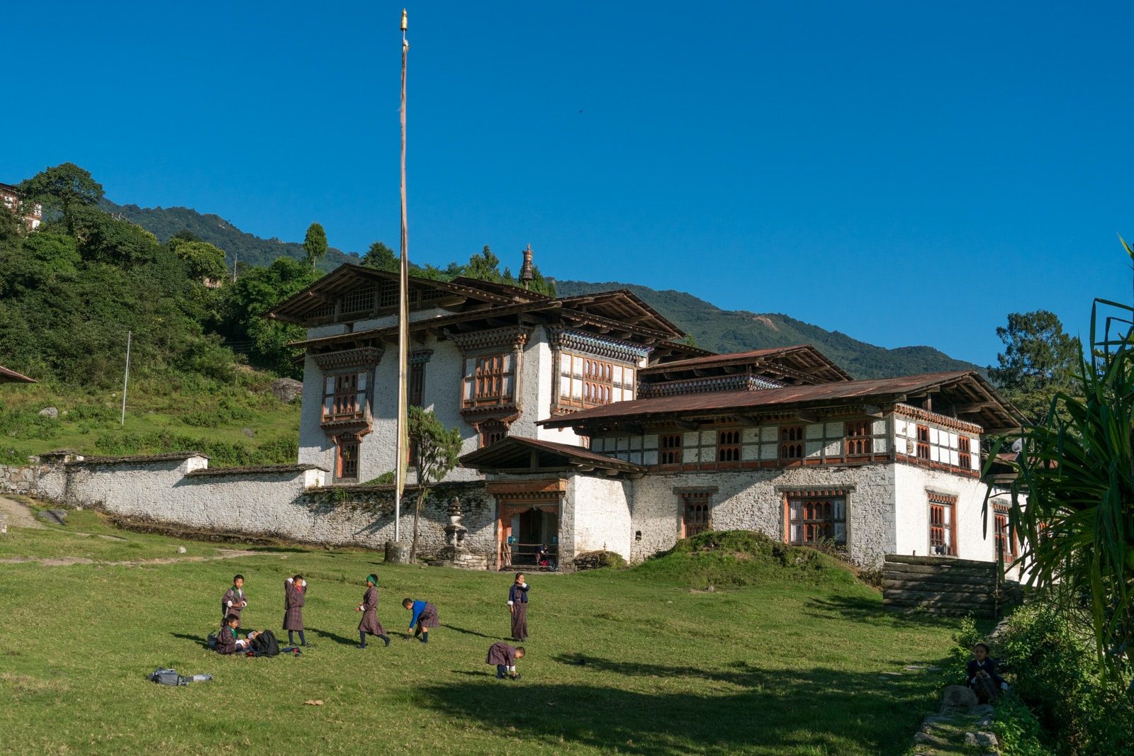 Off the beaten track destinations in Bhutan - School kids outside Kuengarabten palace - Lost With Purpose travel blog