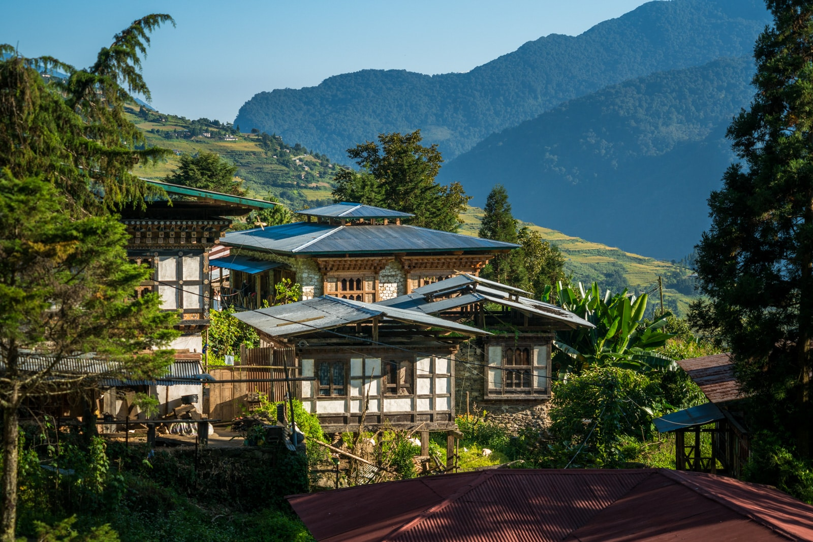 Off the beaten track destinations in Bhutan - Traditional Bhutanese houses in Kuengarabten village - Lost With Purpose travel blog