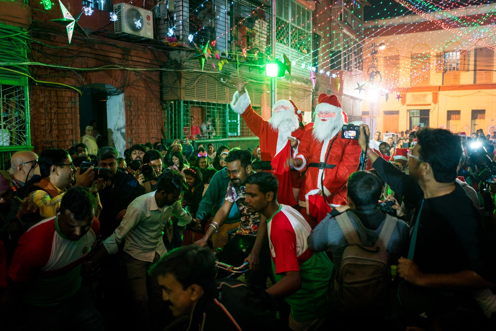 Celebrating Christmas in Kolkata, India - Santas riding on a rickshaw in Barracks on Christmas Eve - Lost With Purpose travel blog