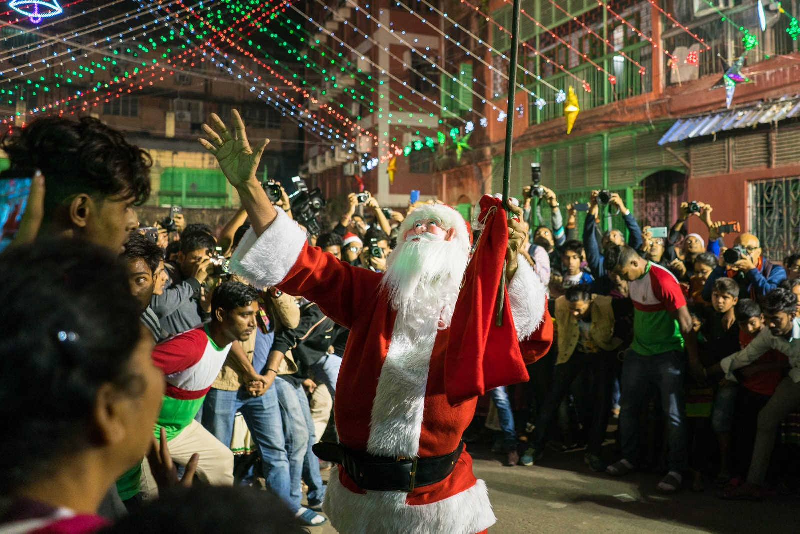 Celebrating Christmas in Kolkata, India - Santas dancing in the crowd at Barracks - Lost With Purpose travel blog