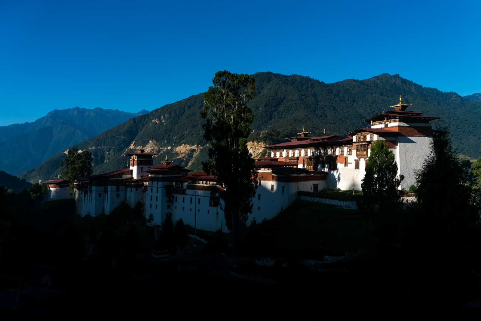 Best places to go off the beaten track in Bhutan - Trongsa dzong at sunrise - Lost With Purpose travel blog