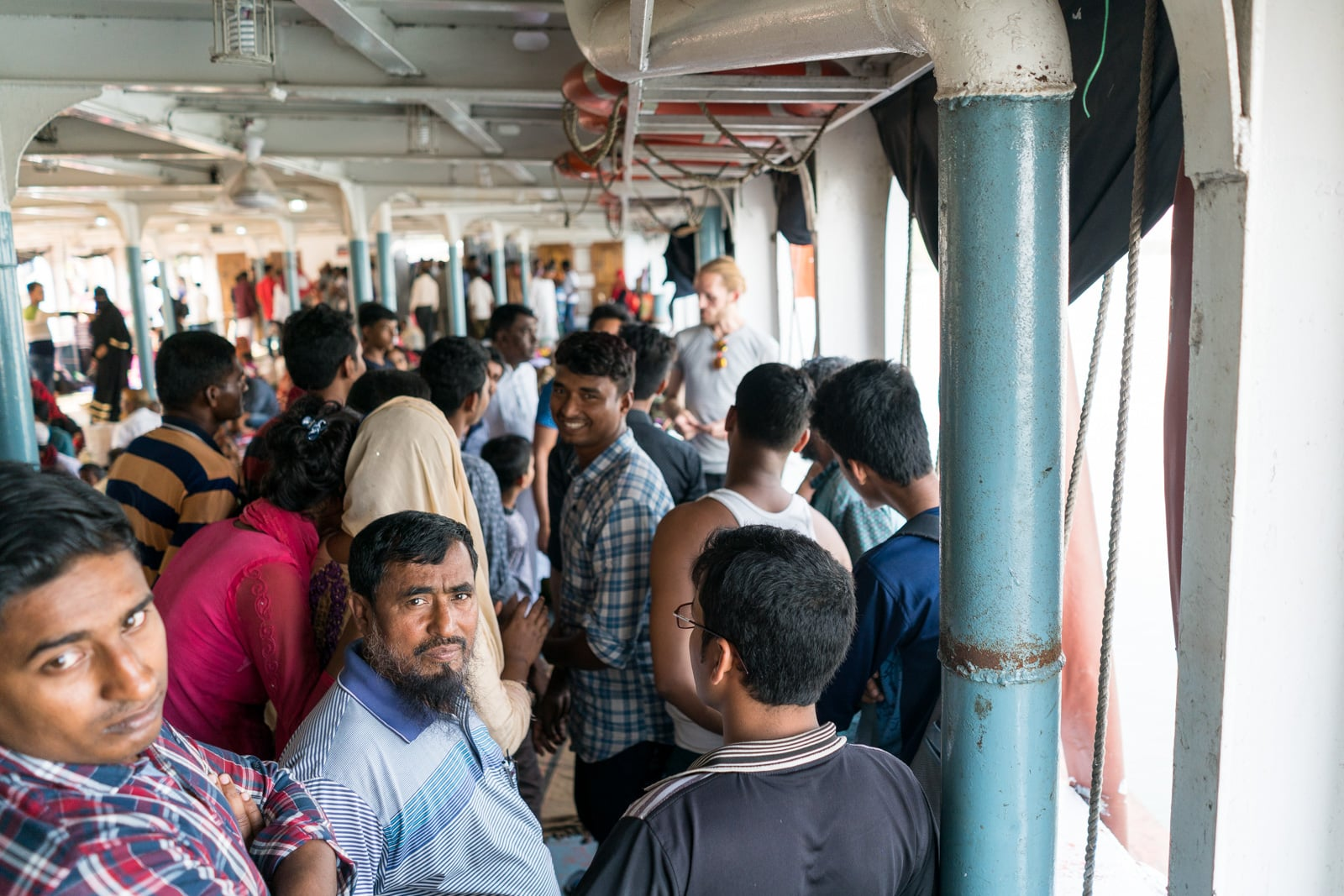 How to get a launch boat from Khulna to Dhaka via Hularhat - Bangladeshi people staring - Lost With Purpose travel blog