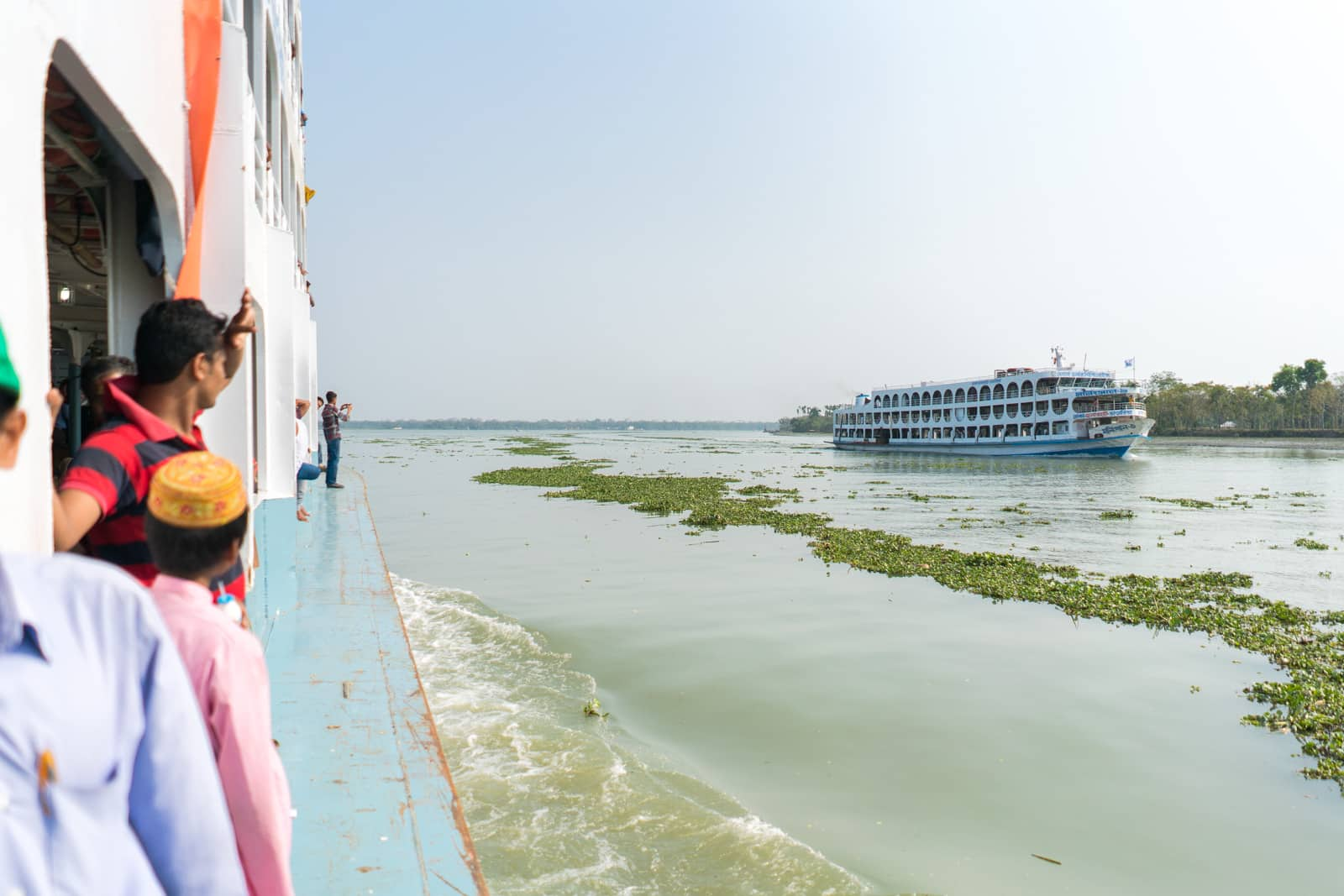 How to get a launch boat from Khulna to Dhaka via Hularhat - Passing launch on the Kaliganga river - Lost With Purpose travel blog