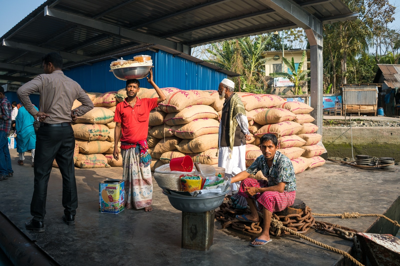 How to get a launch boat from Khulna to Dhaka via Hularhat - Snack salesmen at a dock - Lost With Purpose travel blog