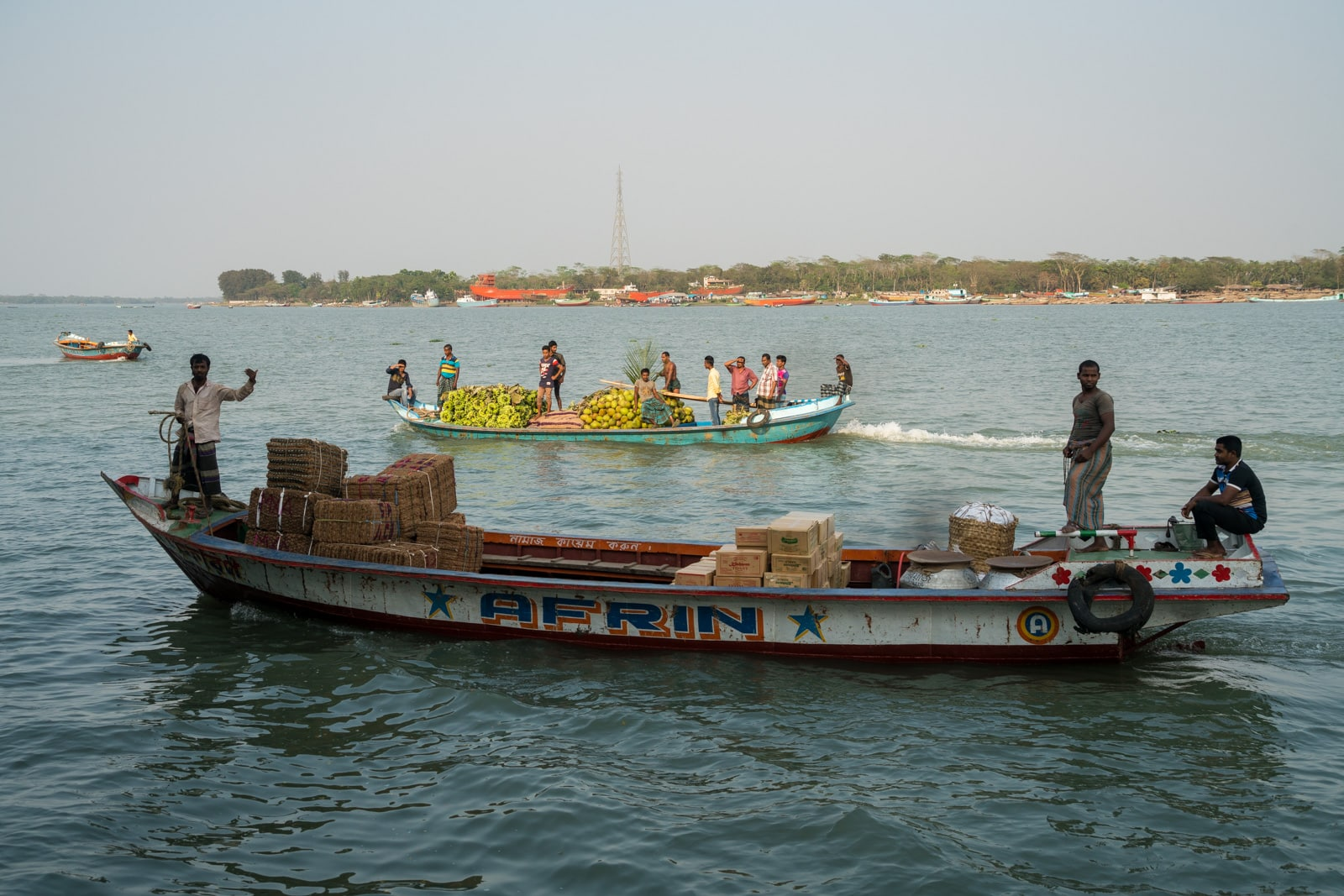 How to get a launch boat from Khulna to Dhaka via Hularhat - Boats passing by on the river in Bangladesh - Lost With Purpose travel blog