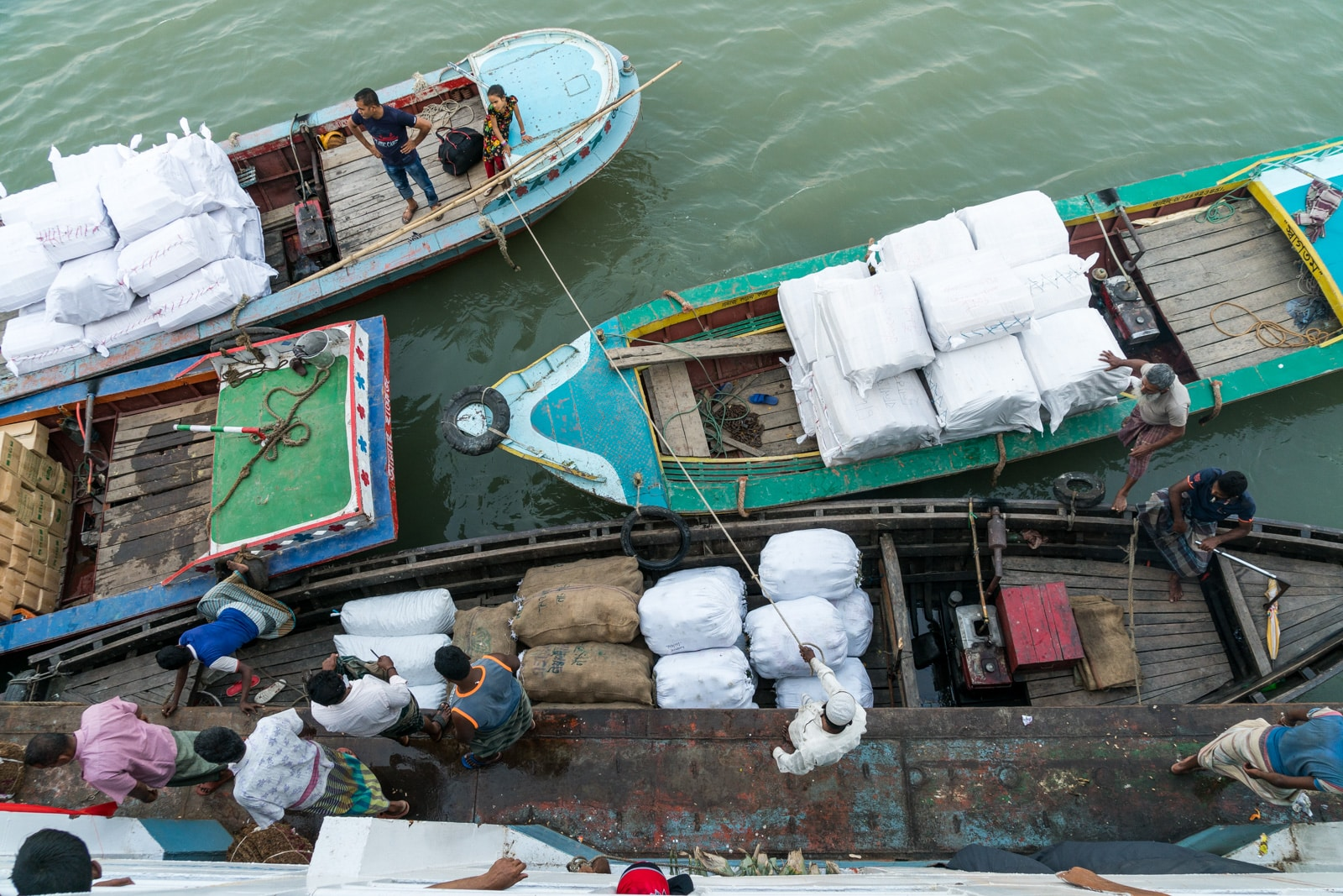 How to get a launch boat from Khulna to Dhaka via Hularhat - People loading cargo onto the launch in Bangladesh - Lost With Purpose travel blog