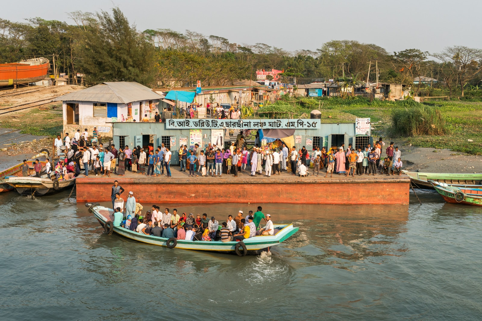 How to take a launch boat from Khulna to Dhaka via Hularhat, Bangladesh - Busy launch terminal on the river - Lost With Purpose travel blog