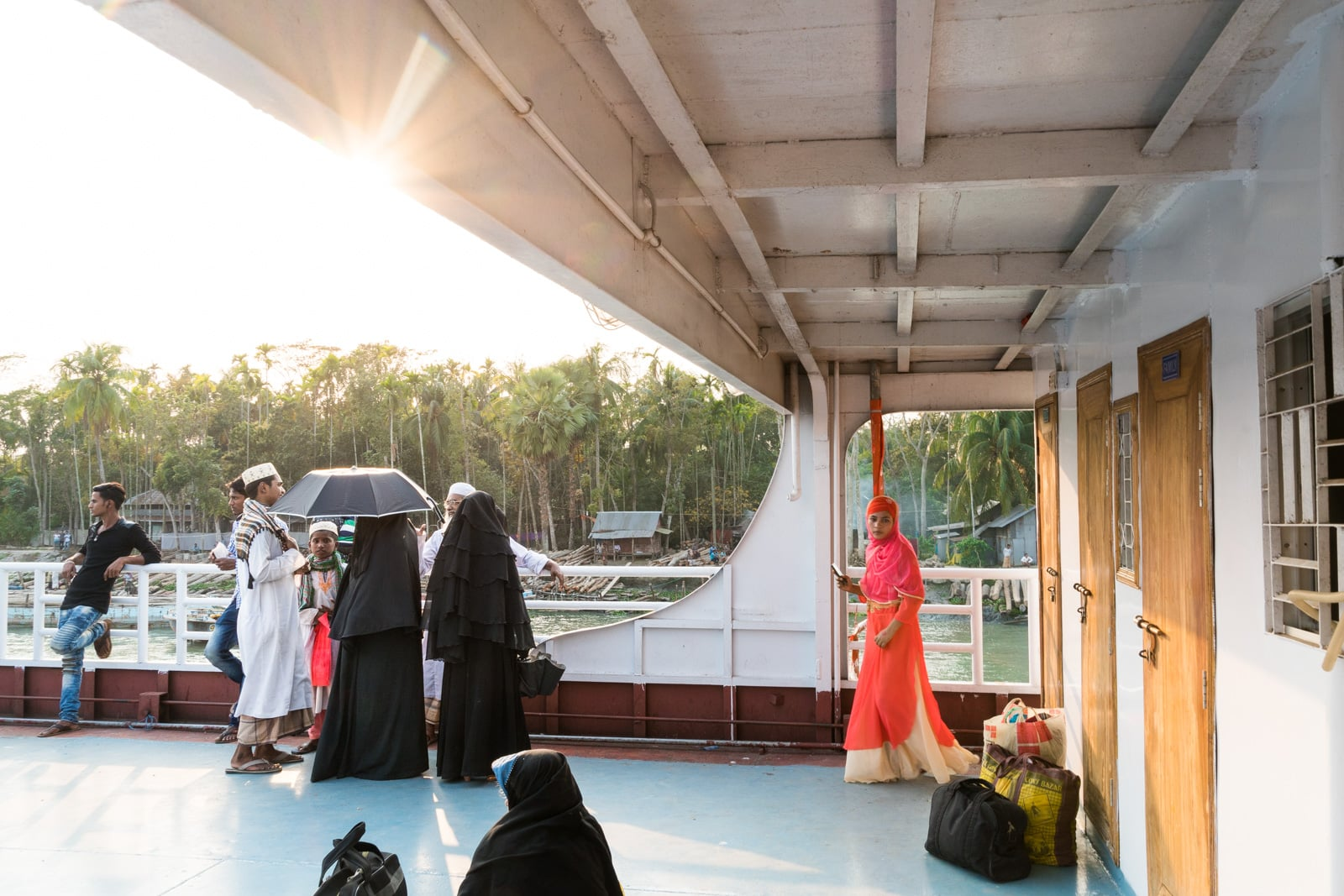 Launches from Hularhat to Dhaka, Bangladesh - Women in burqa looking out from the boat deck - Lost With Purpose travel blog