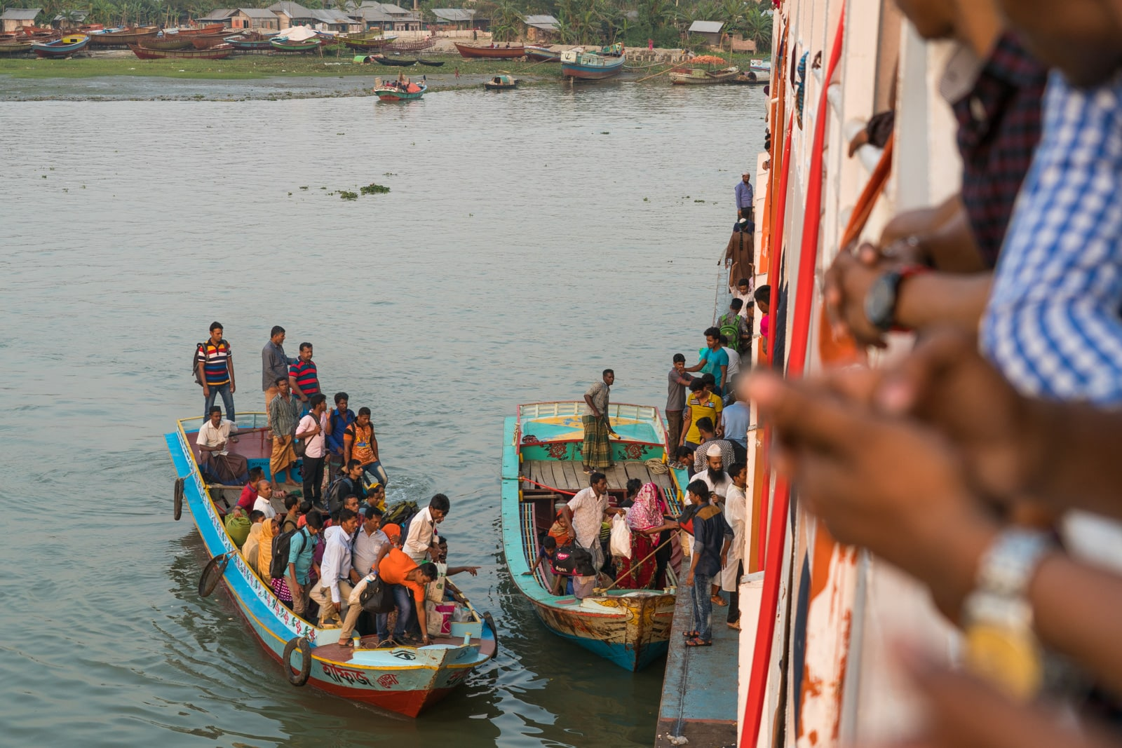 How to take a launch boat from Khulna to Dhaka via Hularhat, Bangladesh - People boating to the launch to climb aboard - Lost With Purpose travel blog
