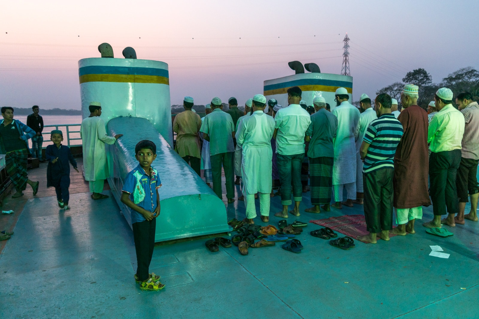 Launches from Hularhat to Dhaka, Bangladesh - Men praying on the boat - Lost With Purpose travel blog