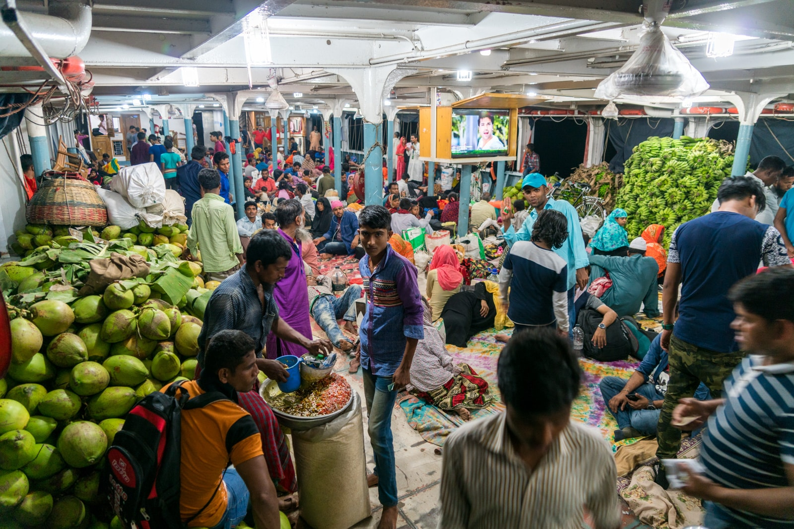 Launches from Hularhat to Dhaka, Bangladesh - Below deck of boat filled with people at night - Lost With Purpose travel blog