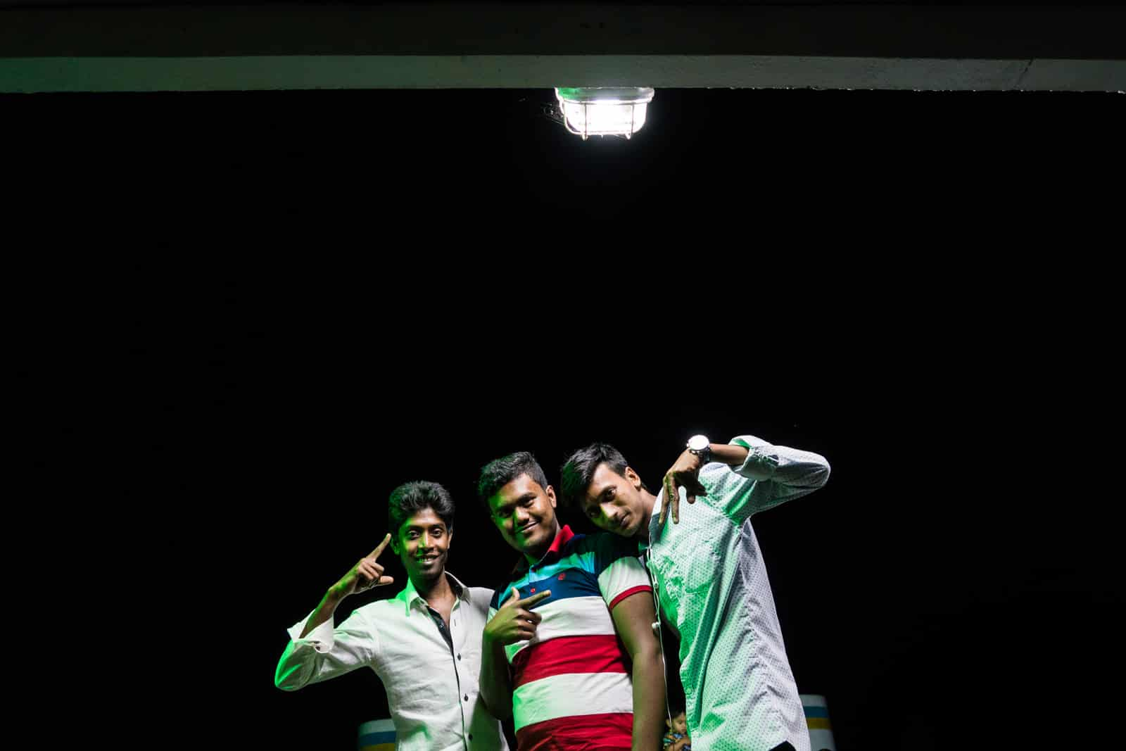 Launches from Hularhat to Dhaka, Bangladesh - Boys posing at night on the launch boat - Lost With Purpose travel blog