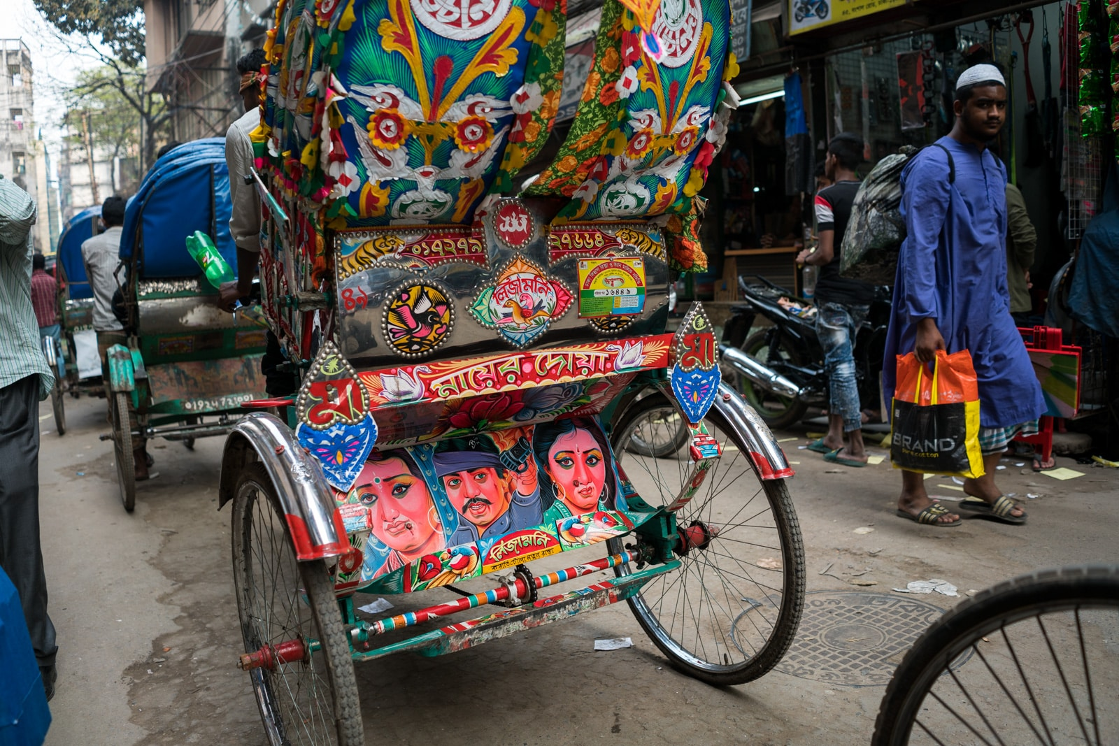 How much it costs to go backpacking in Bangladesh - Colorful cycle rickshaws on the streets of Dhaka - Lost With Purpose travel blog