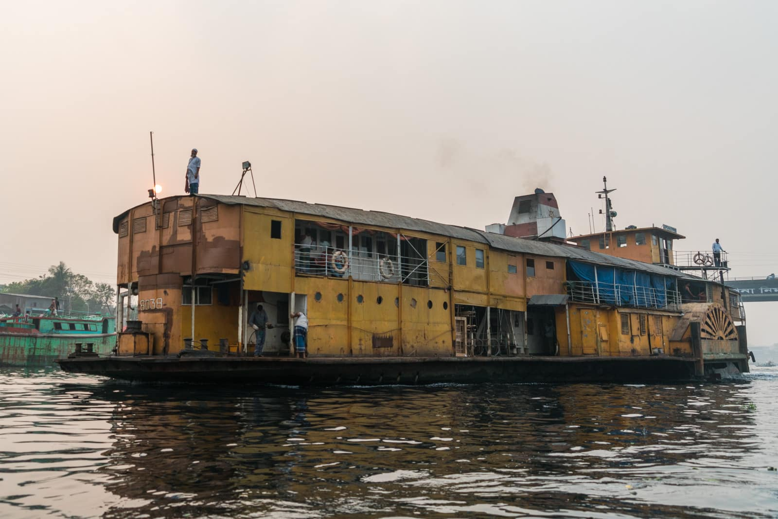 Launches from Hularhat to Dhaka, Bangladesh - Rocket Steamer pulling into Dhaka River Port - Lost With Purpose travel blog