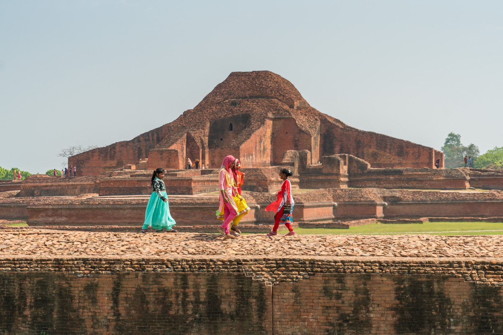 How much it costs to go backpacking in Bangladesh - Girls walking at Sompur Mahavihara in Paharpur - Lost With Purpose travel blog