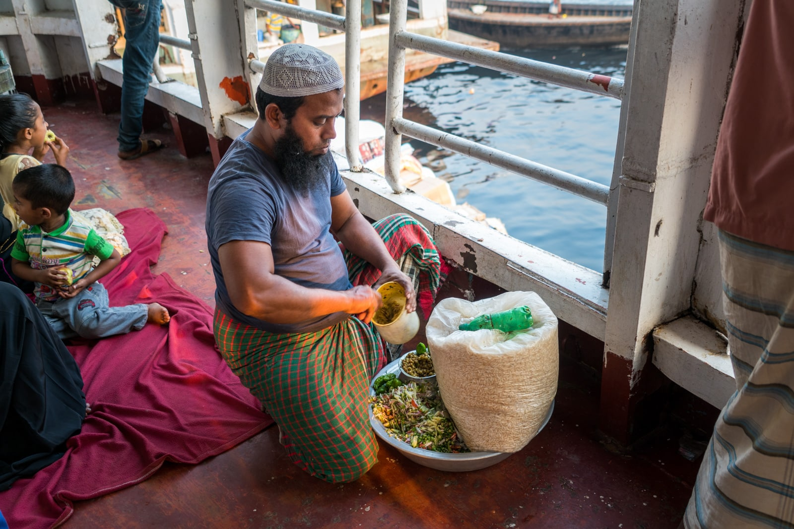 Guide to launches in Bangladesh - Man making jhal muri puffed rice - Lost With Purpose travel blog