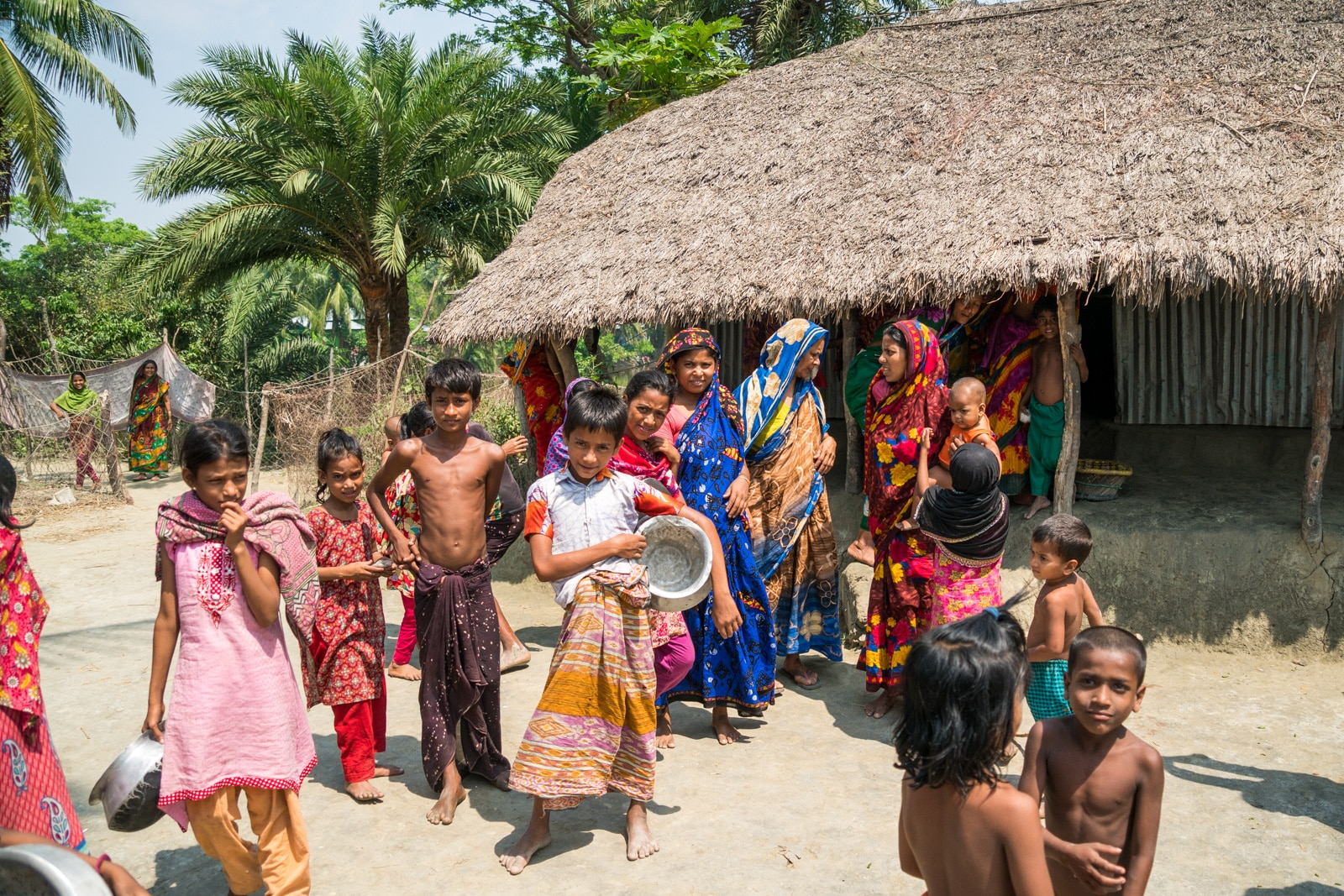 Guide to Nijhum Dwip, Bangladesh - Villagers outside a hut - Lost With Purpose travel blog
