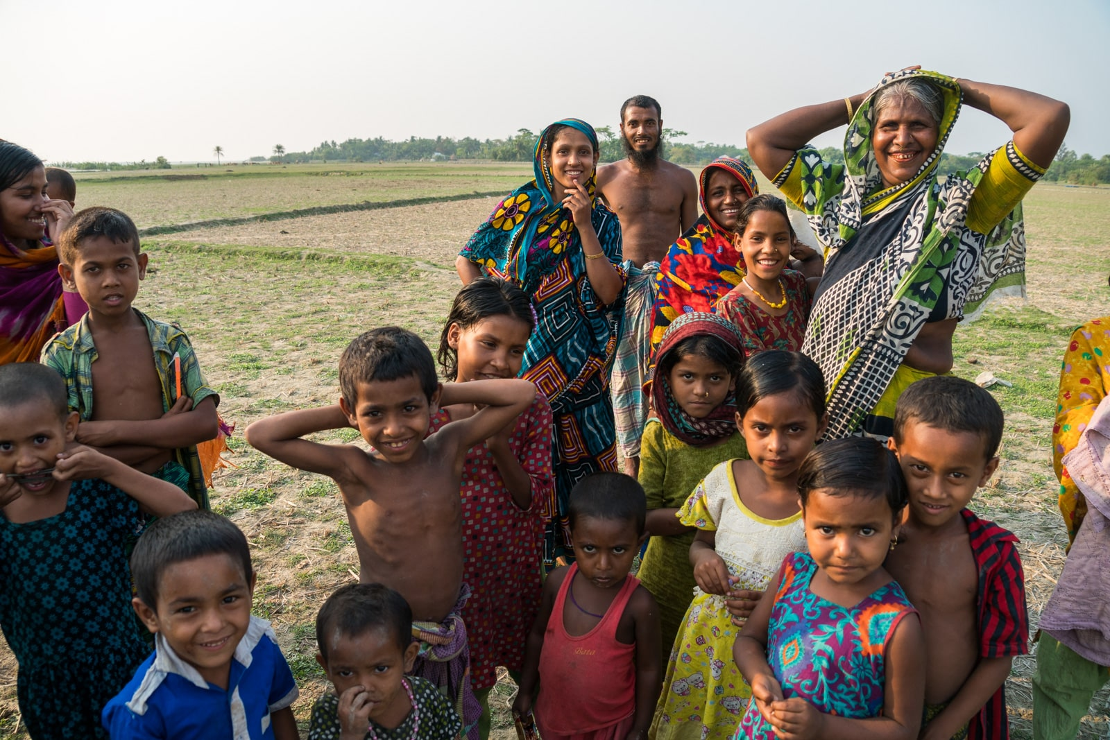 Travel guide to Nijhum Dwip, Bangladesh - Group of curious villagers - Lost With Purpose travel blog