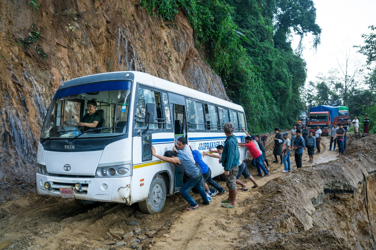 Off the beaten track Bhutan - Bus stuck in the mud - Lost With Purpose travel blog