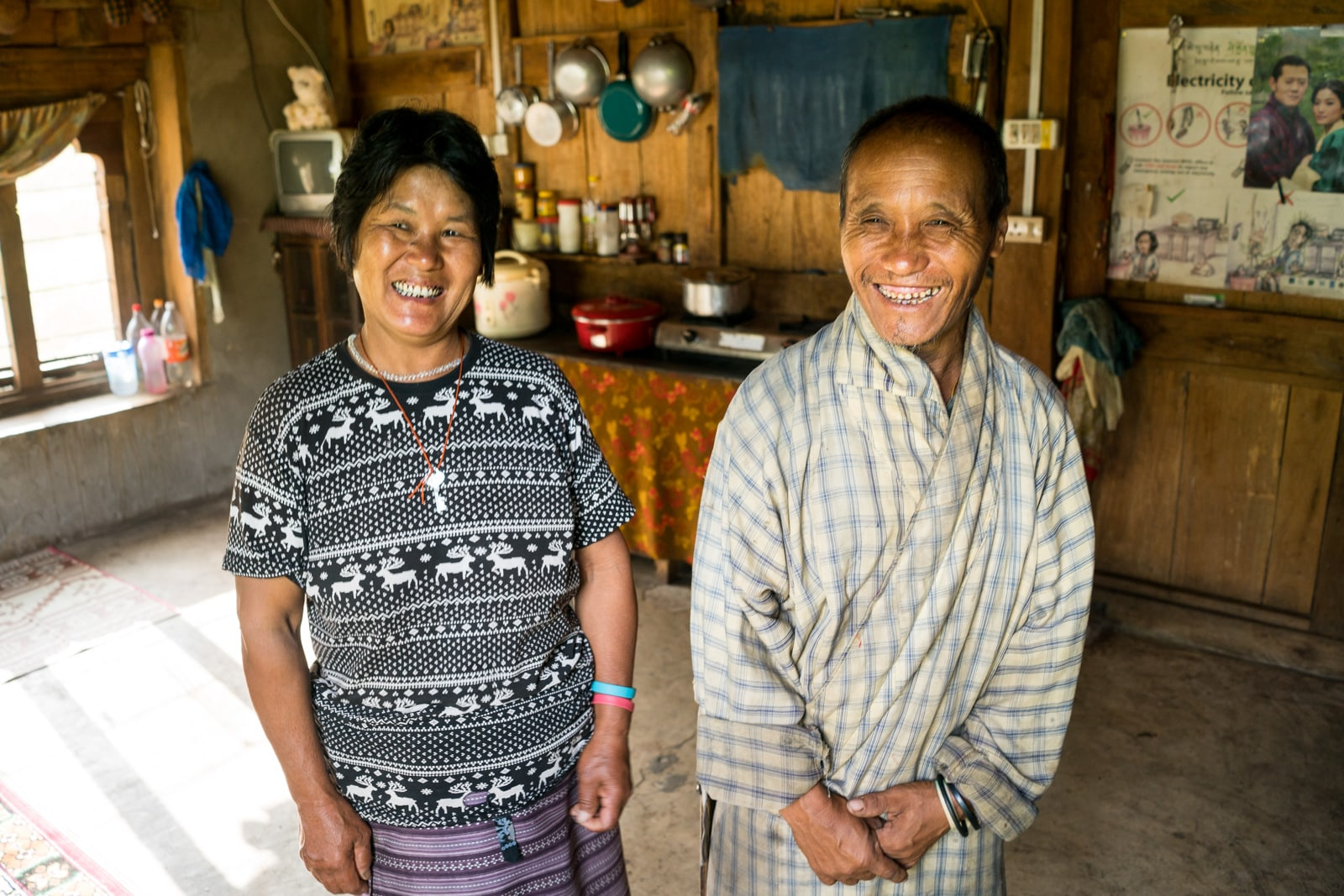 Where to go off the beaten track in Bhutan - Homestay host and hostess in Birtii, Zhemgang district - Lost With Purpose travel blog