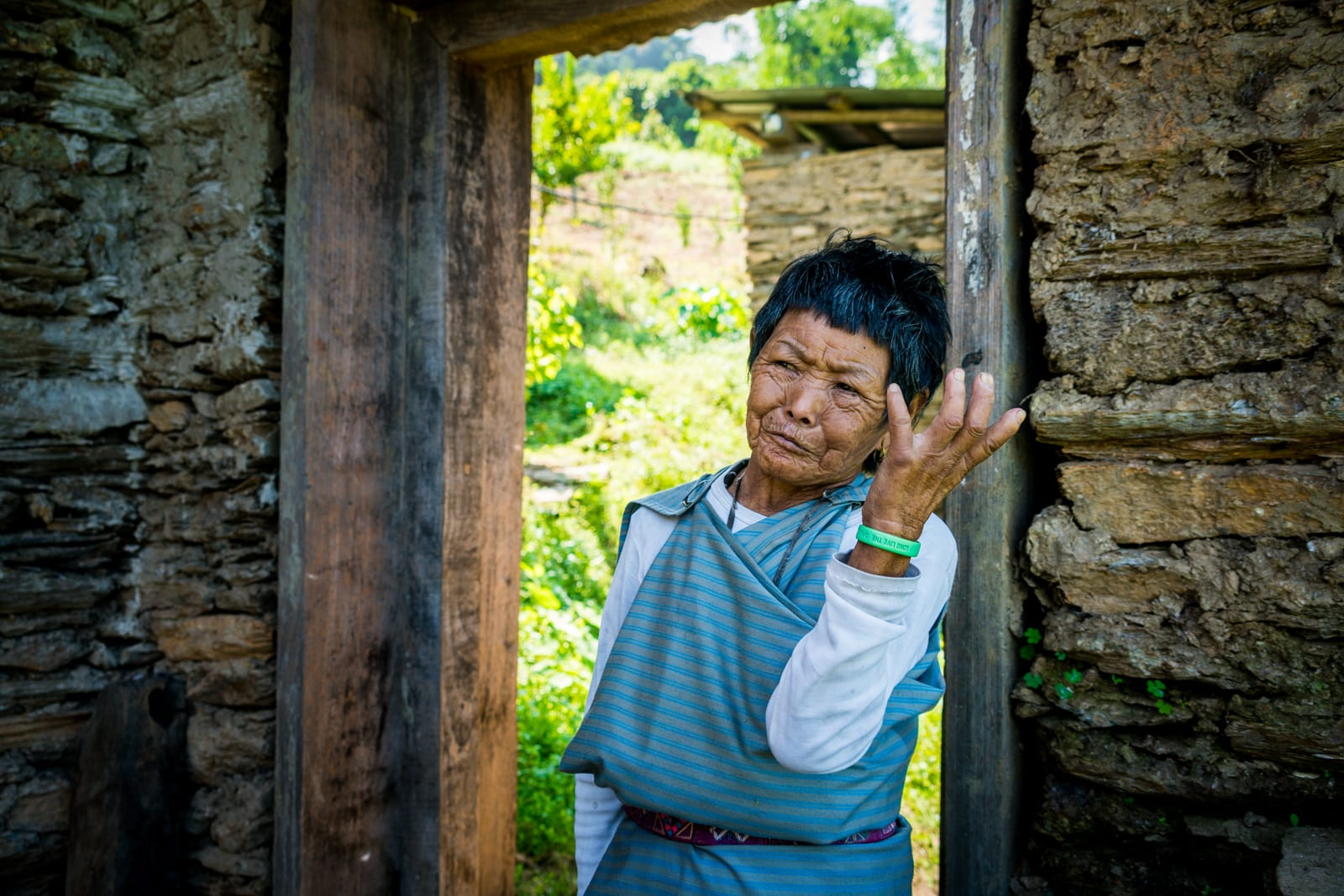 How to go off the beaten track in Bhutan - Old grandmother in Tingtibi - Lost With Purpose travel blog