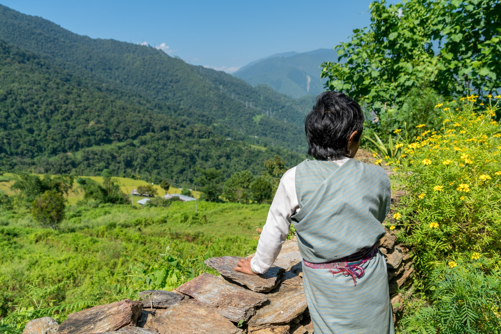 Where to go off the beaten track in Bhutan - Old woman looking downhill in Zhemgang district - Lost With Purpose travel blog