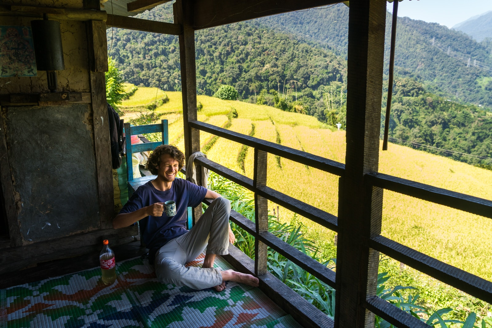 Off the beaten track destinations in Bhutan - Sebastiaan drinking singchiang rice wine outside of Tingtibi - Lost With Purpose travel blog