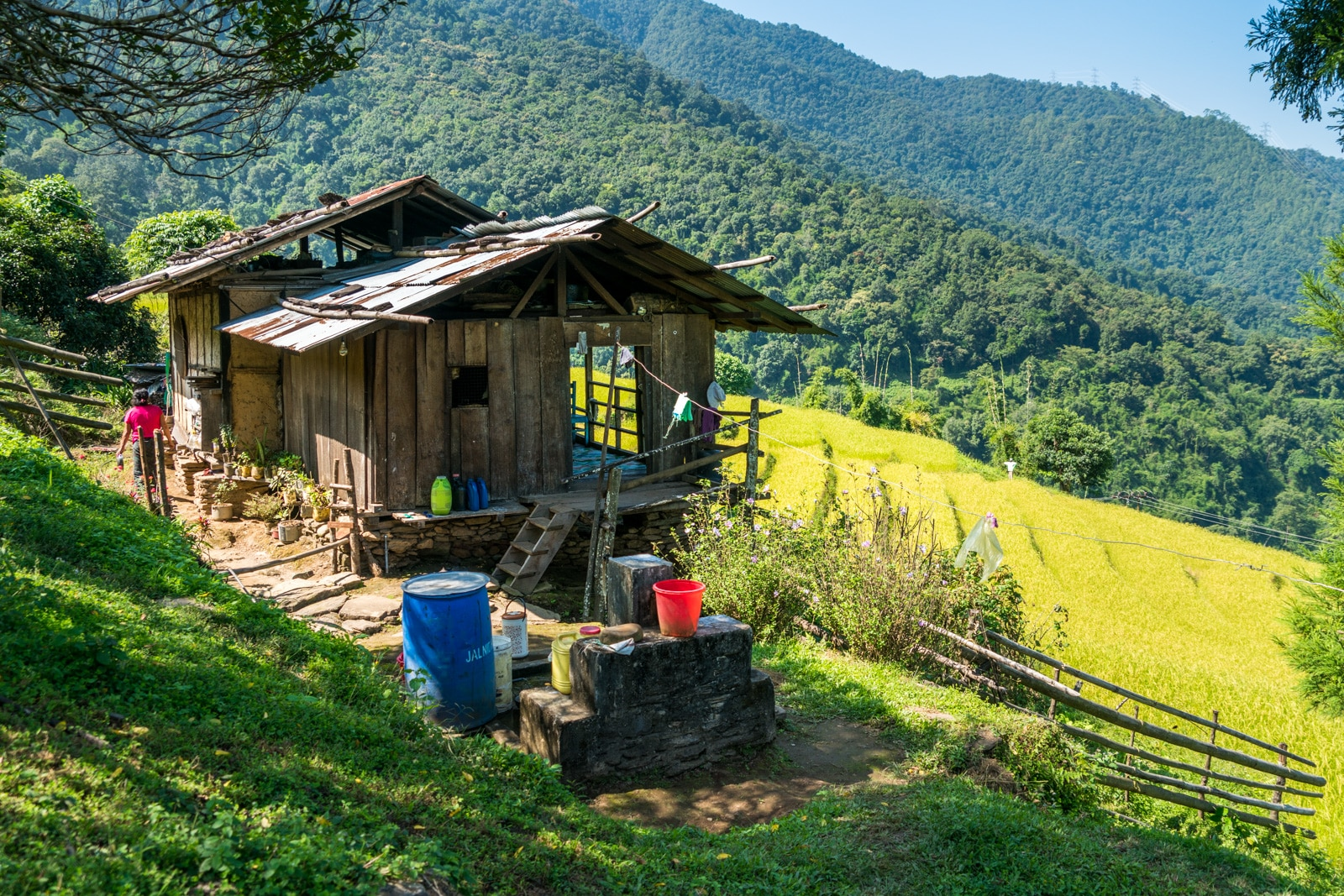 Going off the beaten track in Bhutan - House overlooking rice paddies near Tingtibi, Zhemgang district - Lost With Purpose travel blog