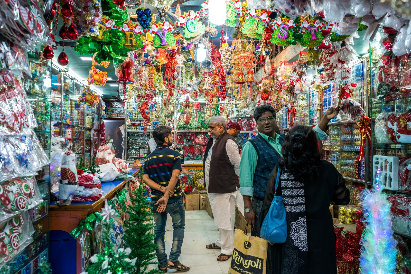 Celebrating Christmas in Kolkata, India - Muslim man selling Christmas decorations on Mirza Ghalib street - Lost With Purpose travel blog
