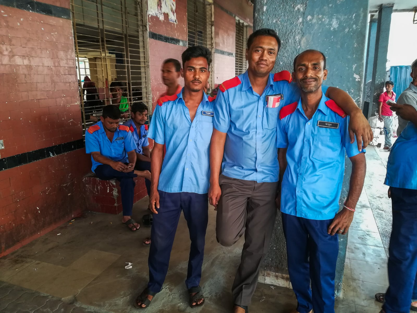 How to buy launch tickets in Dhaka, Bangladesh - Friendly porters at Sadarghat launch terminal - Lost With Purpose travel blog