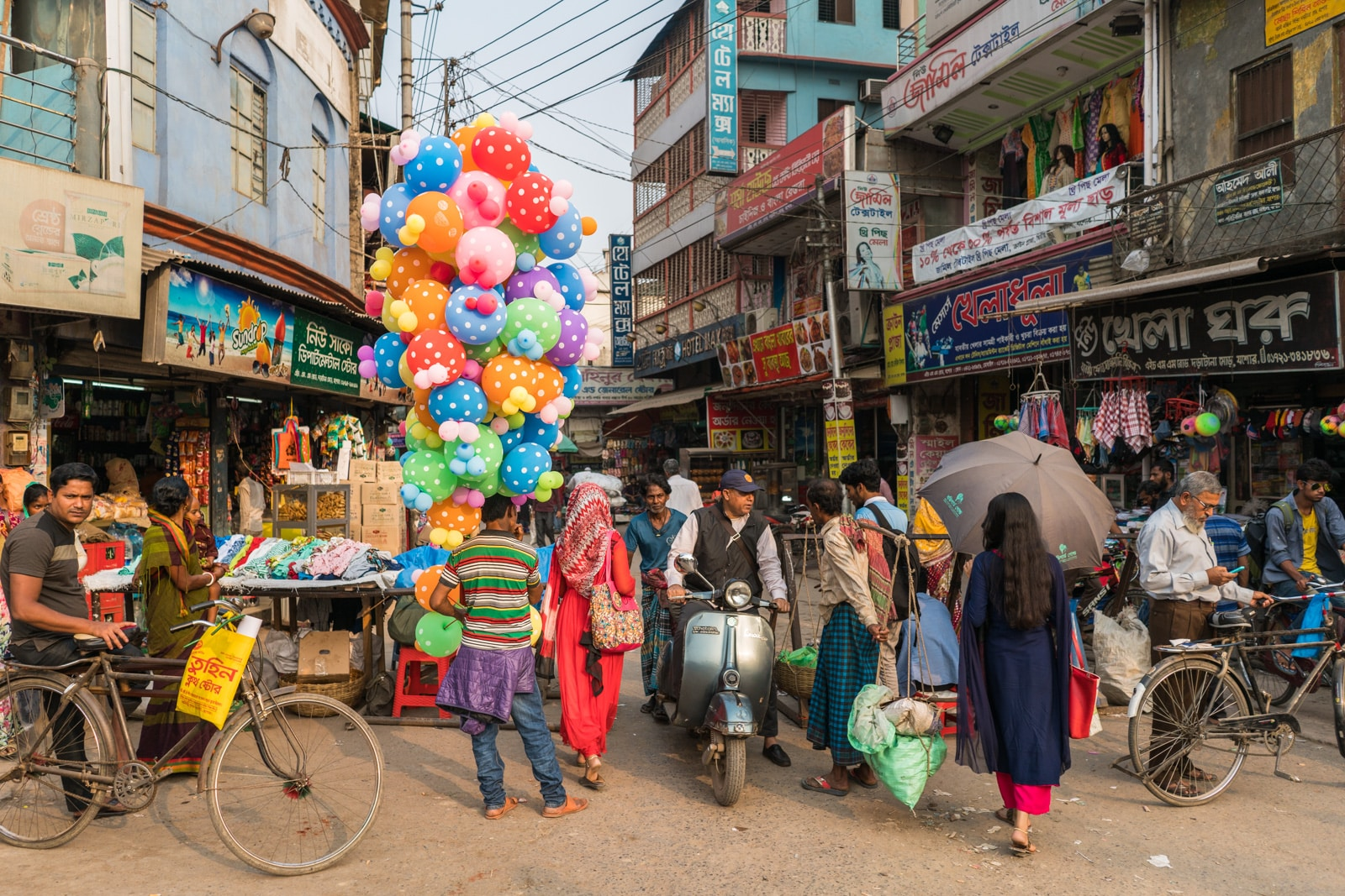 Backpacking in Bangladesh travel guide - Rainbow balloon salesman in central Jessore - Lost With Purpose travel blog