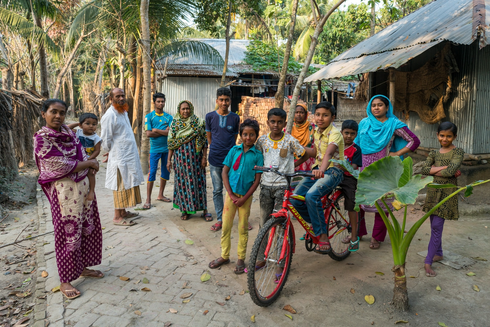 Backpacking in Bangladesh travel guide - friendly locals in a village outside Khulna - Lost With Purpose travel blog