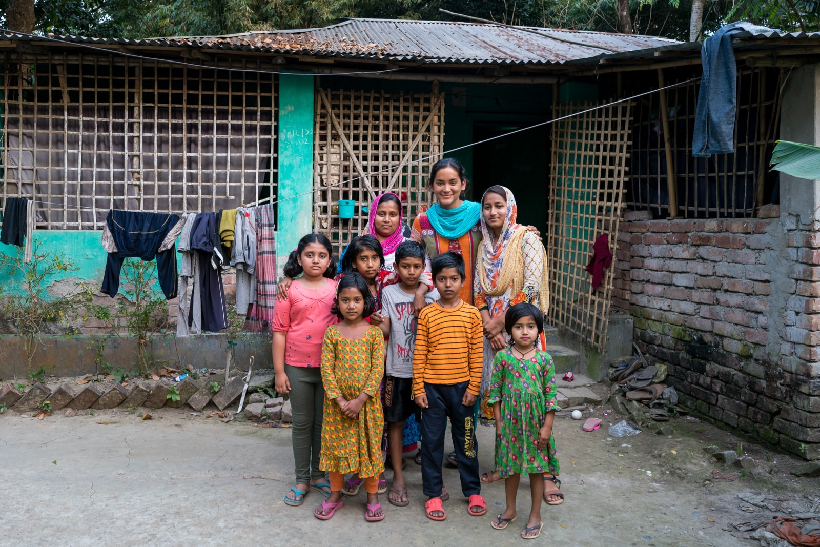 Is Bangladesh safe for female travelers - Alex chilling with a family in a village outside of Khulna - Lost With Purpose travel blog