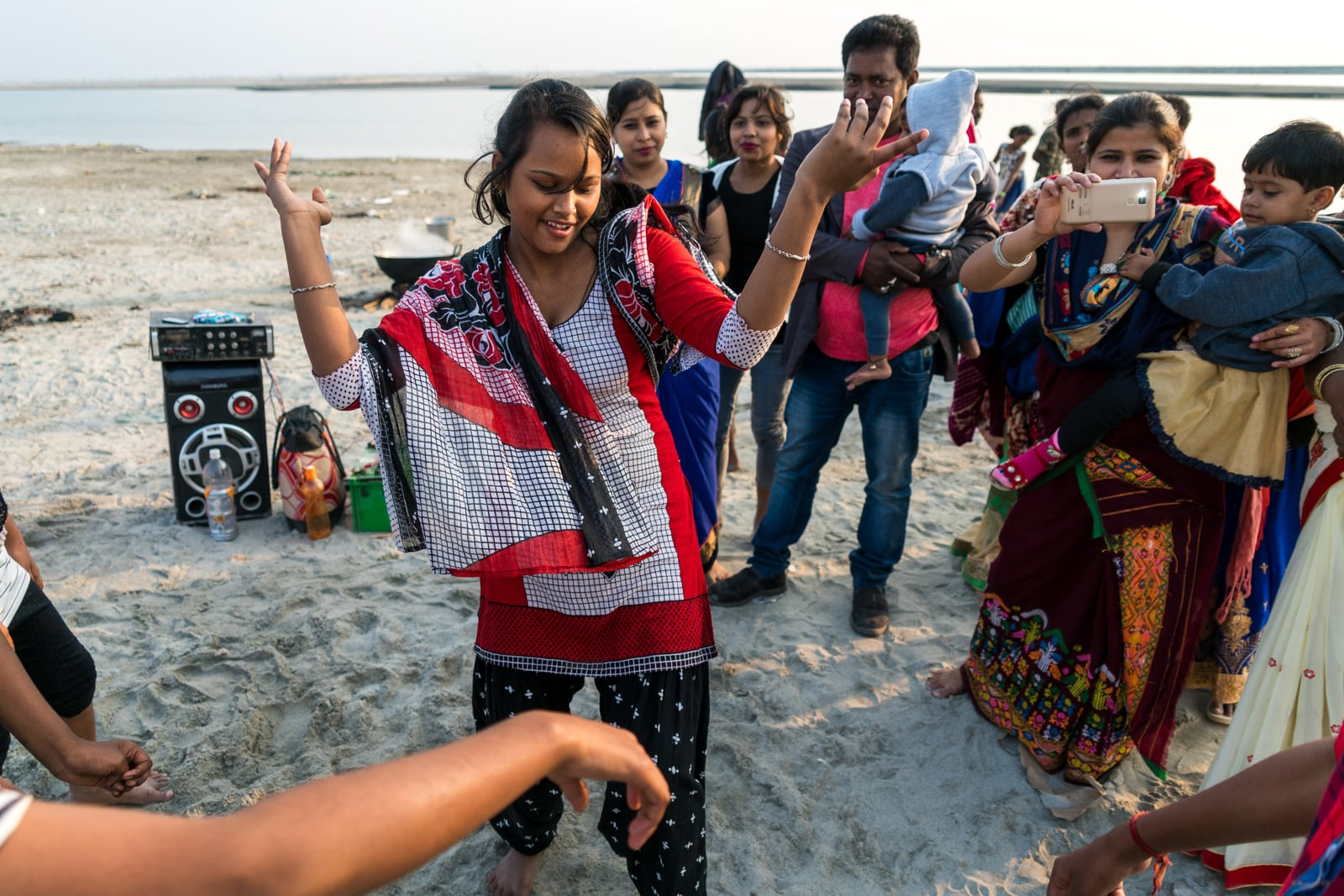 Easy ways to travel more responsibly - Dancing girl on Majuli river island in Assam, India - Lost With Purpose travel blog