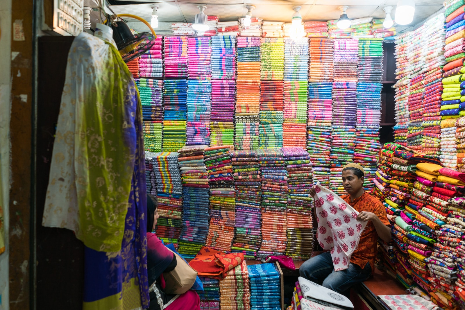 Backpacking Bangladesh travel guide - Colorful fabrics on sale in New Market, Dhaka - Lost With Purpose travel blog