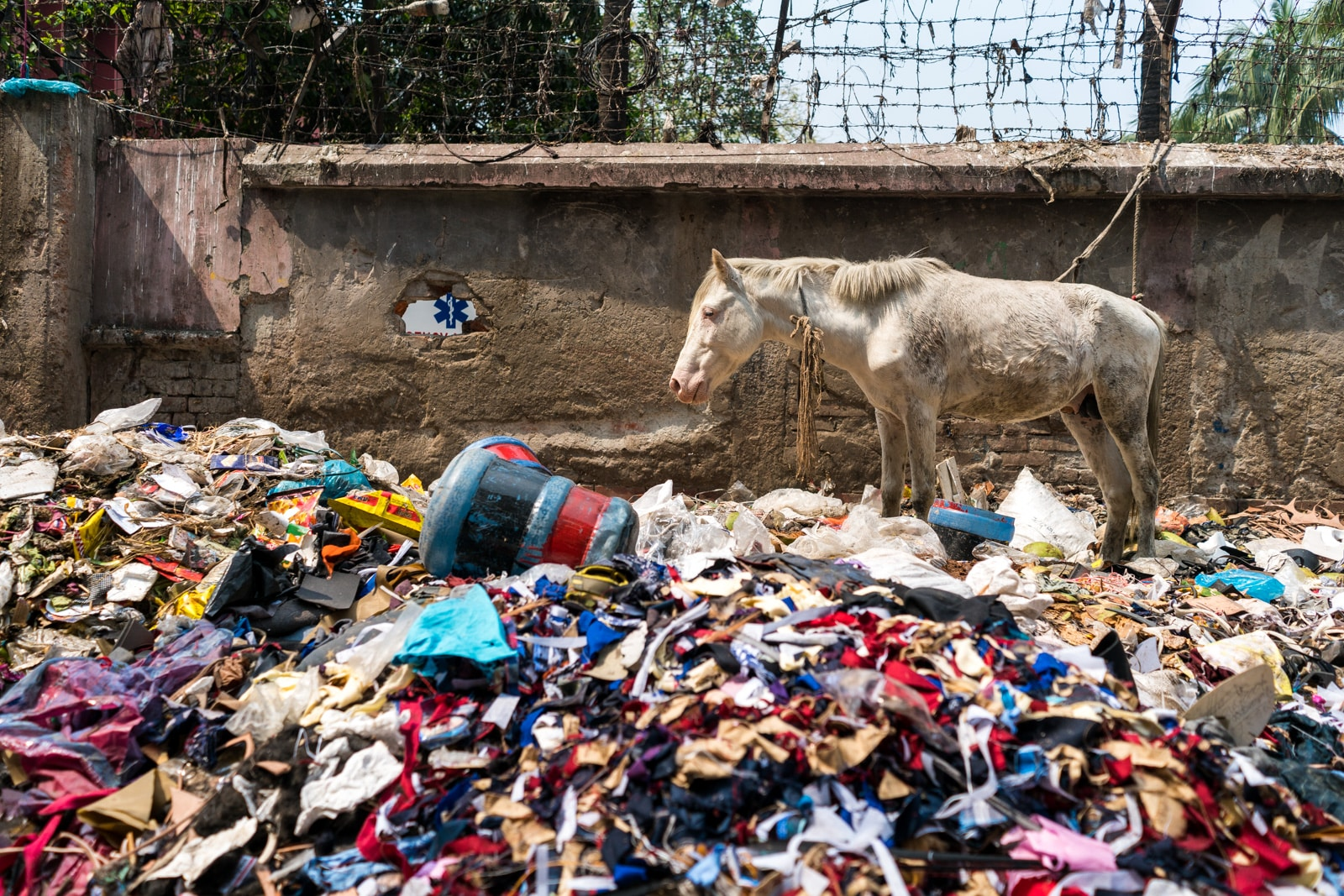 Easy ways to be a more responsible traveler - Pile of trash on the streets of Dhaka, Bangladesh - Lost With Purpose travel blog