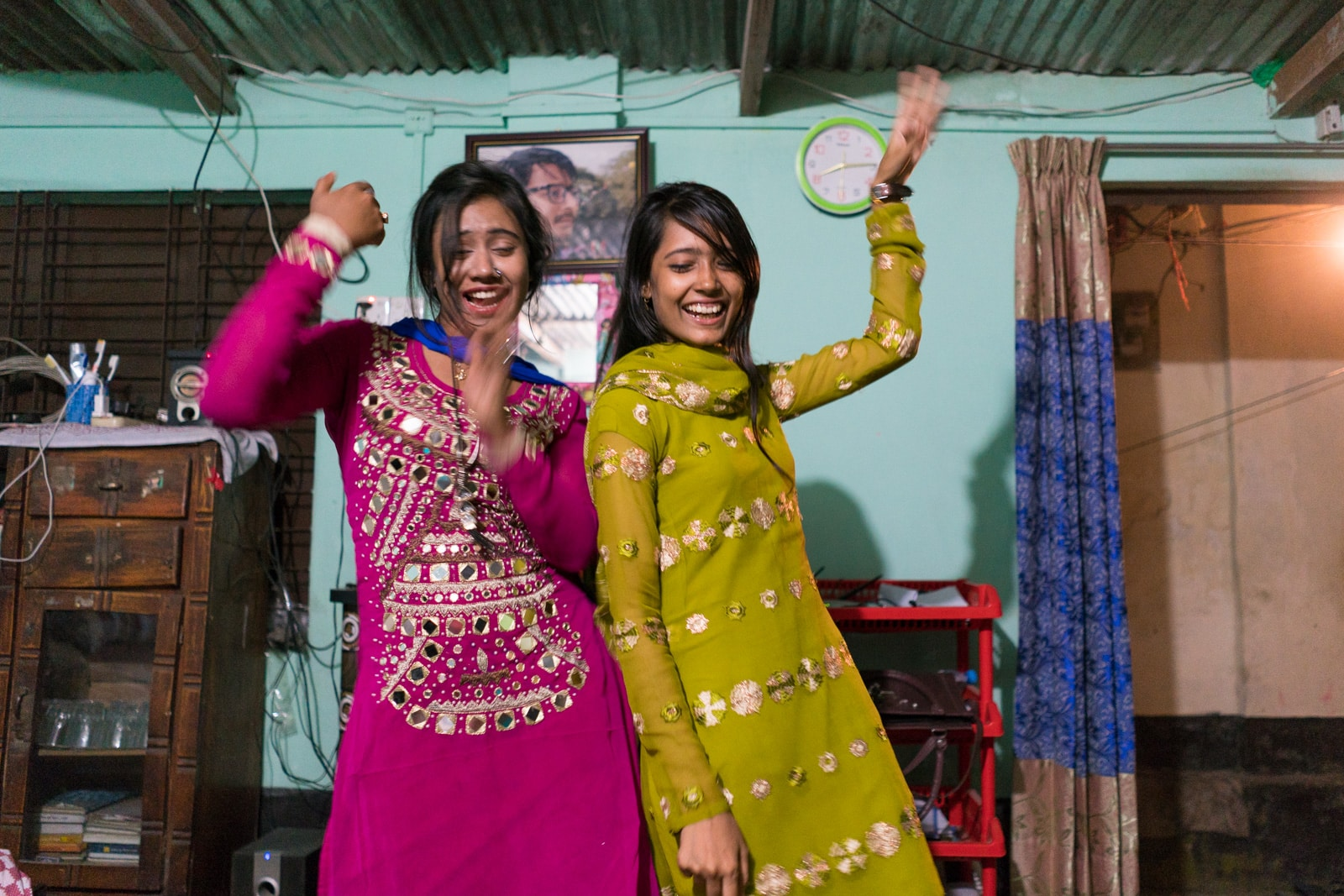 Female travel in Bangladesh - Girls dancing in a room outside Dhaka - Lost With Purpose travel blog