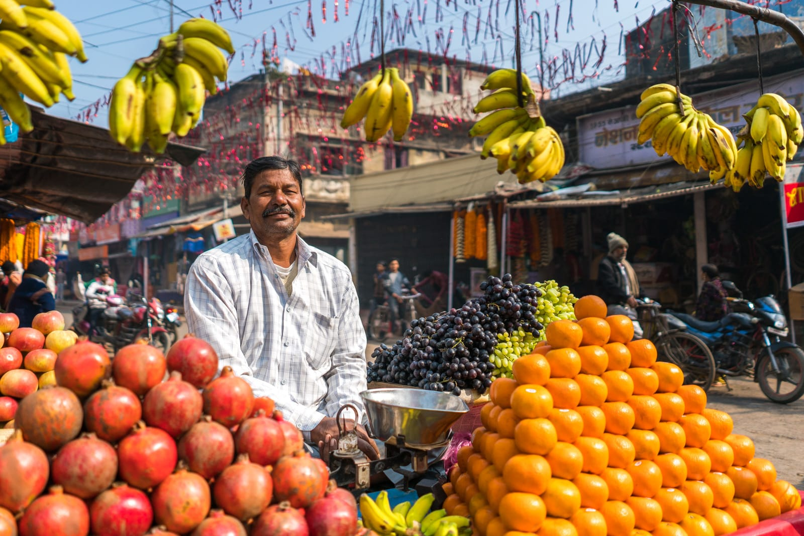 Easy ways to be a more responsible traveler - Fruit salesman in Bihar, India - Lost With Purpose travel blog
