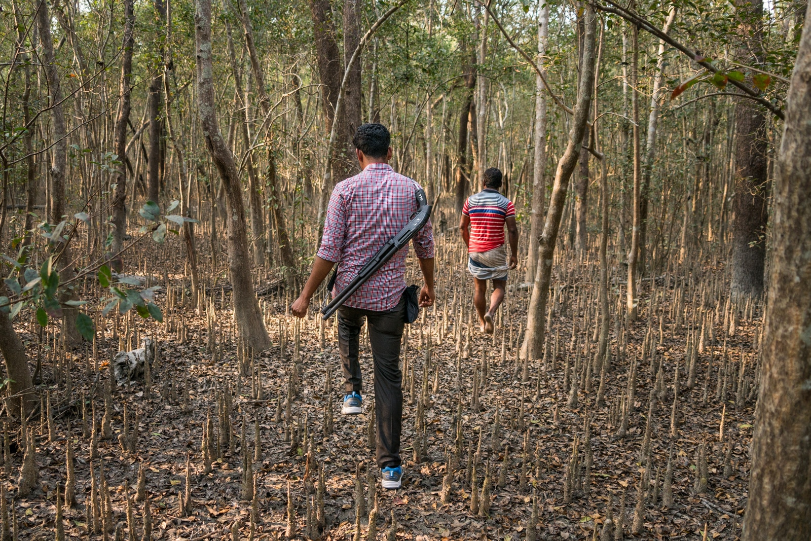 Solo female travel in Bangladesh - Guard with gun walking in Nijhum Dwip National Park - Lost With Purpose travel blog