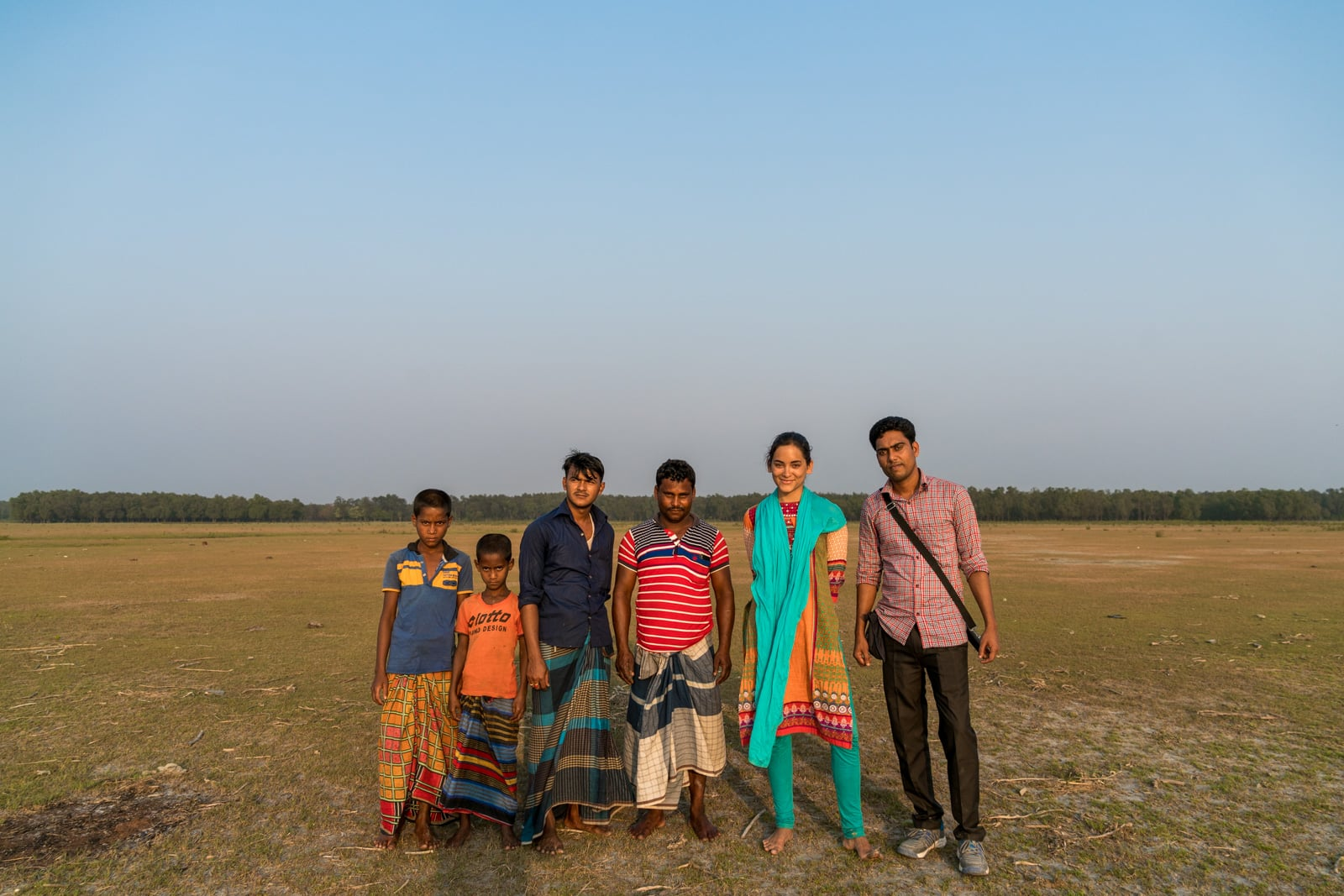 Guide to solo female travel in Bangladesh - Alex with a group of men in Nijhum Dwip - Lost With Purpose travel blog