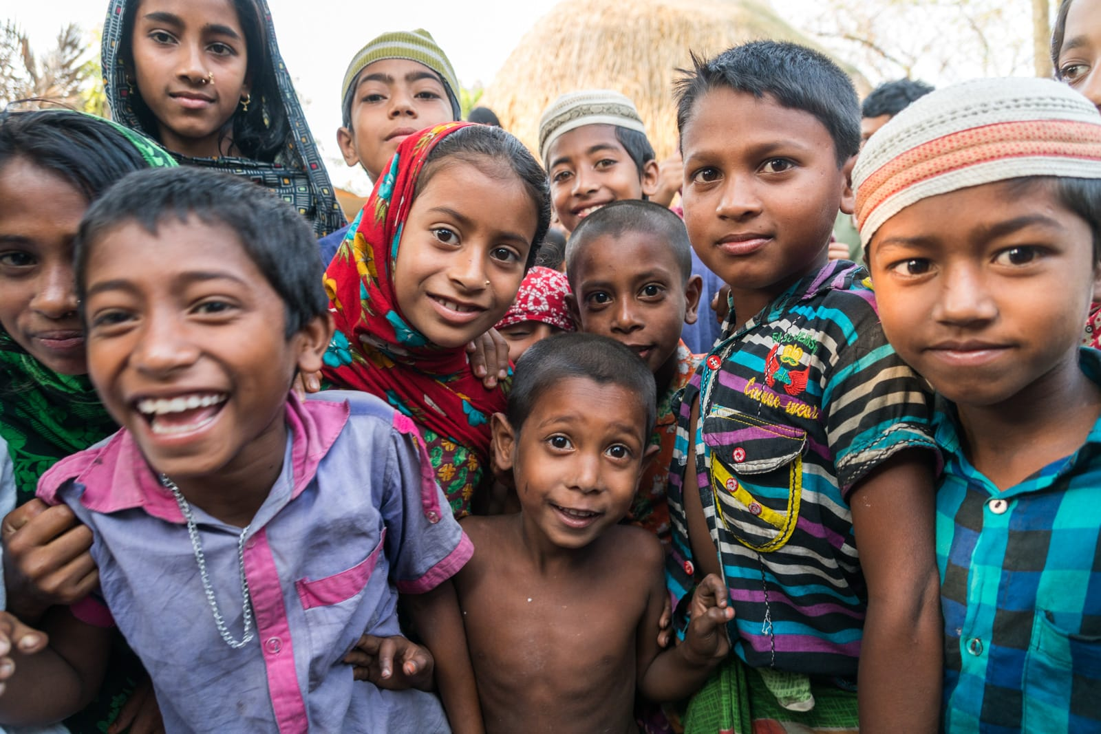 Backpacking in Bangladesh travel guide - Friendly kids in Nijhum Dwip - Lost With Purpose travel blog
