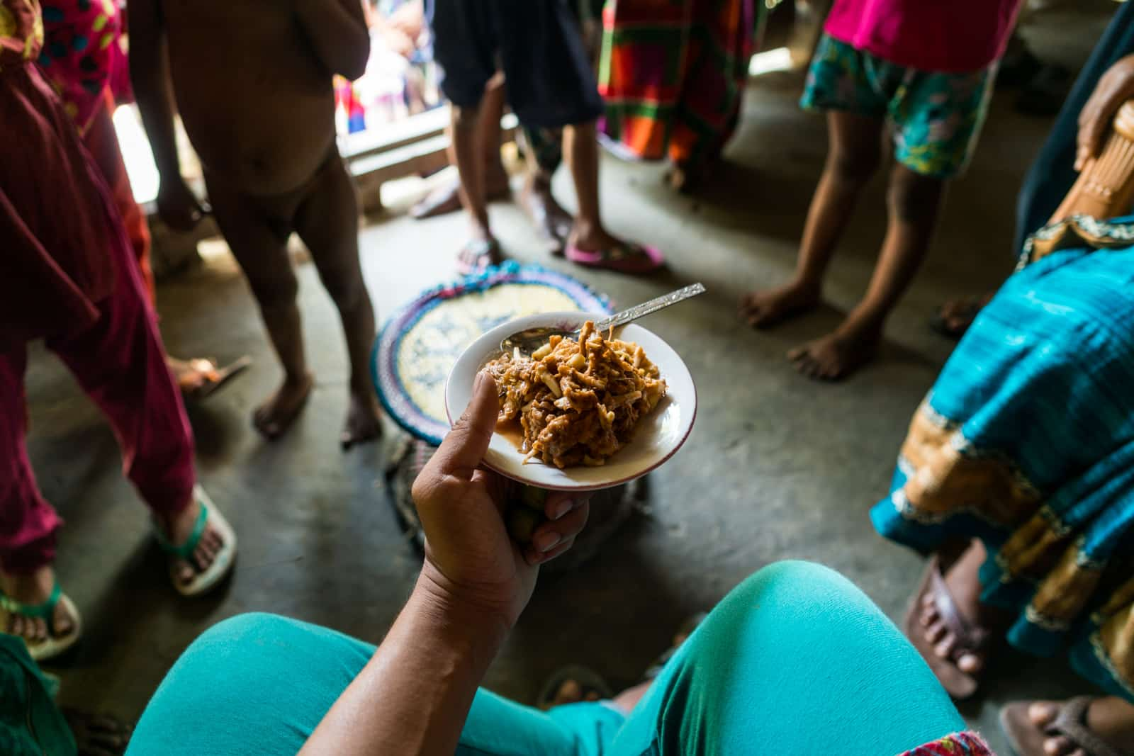 Guide to female travel in Bangladesh - Invited into a house for snacks and selfies on Nijhum Dwip - Lost With Purpose travel blog