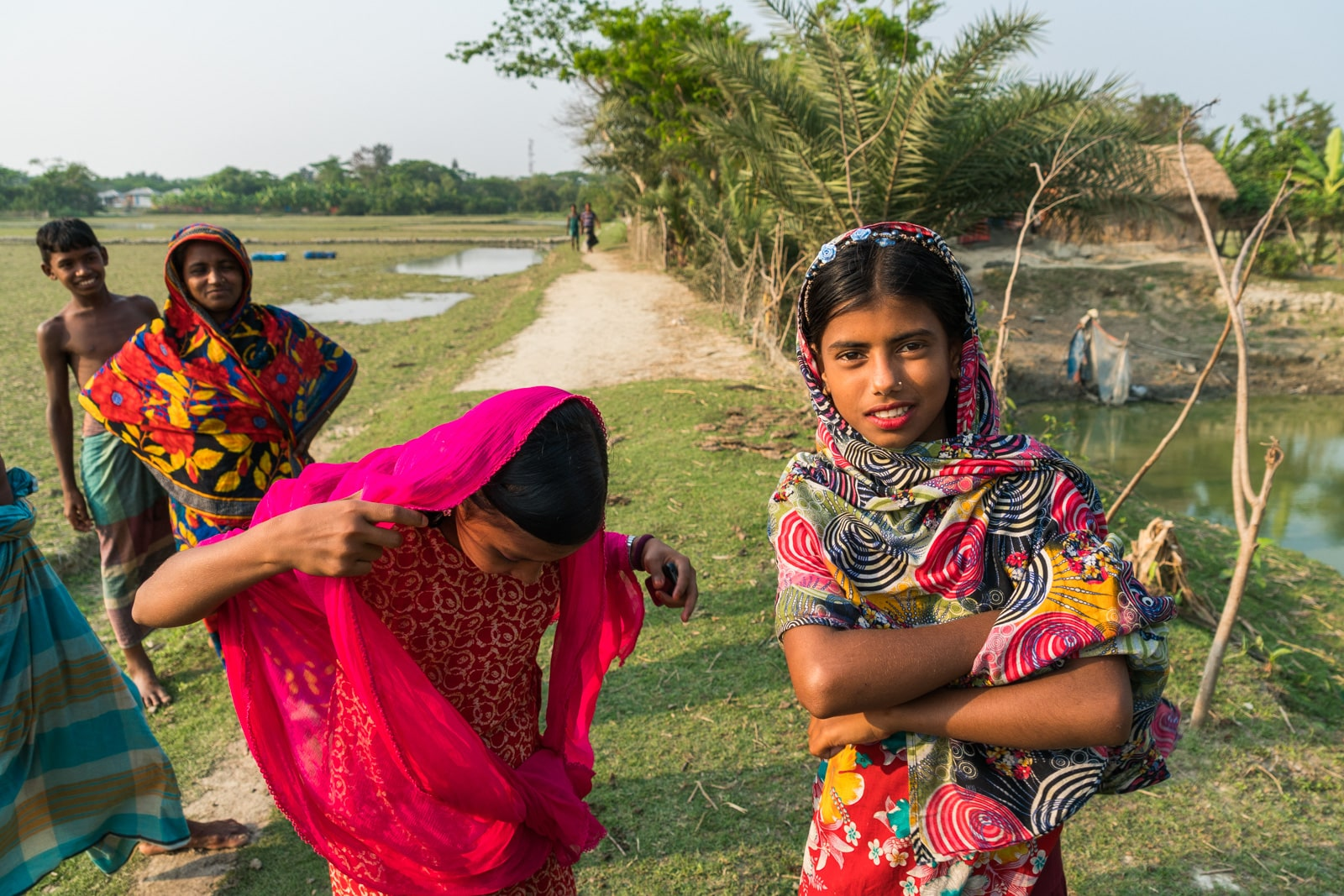 Guide to solo female travel in Bangladesh - Girls in colorful clothes on Nijhum Dwip - Lost With Purpose travel blog