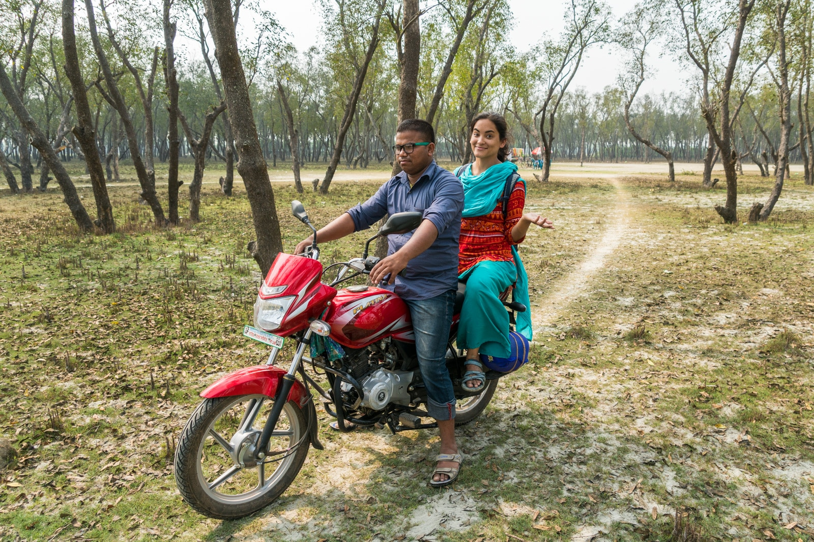 Guide to solo female travel in Bangladesh - Alex on a motorbike with her manescort - Lost With Purpose travel blog