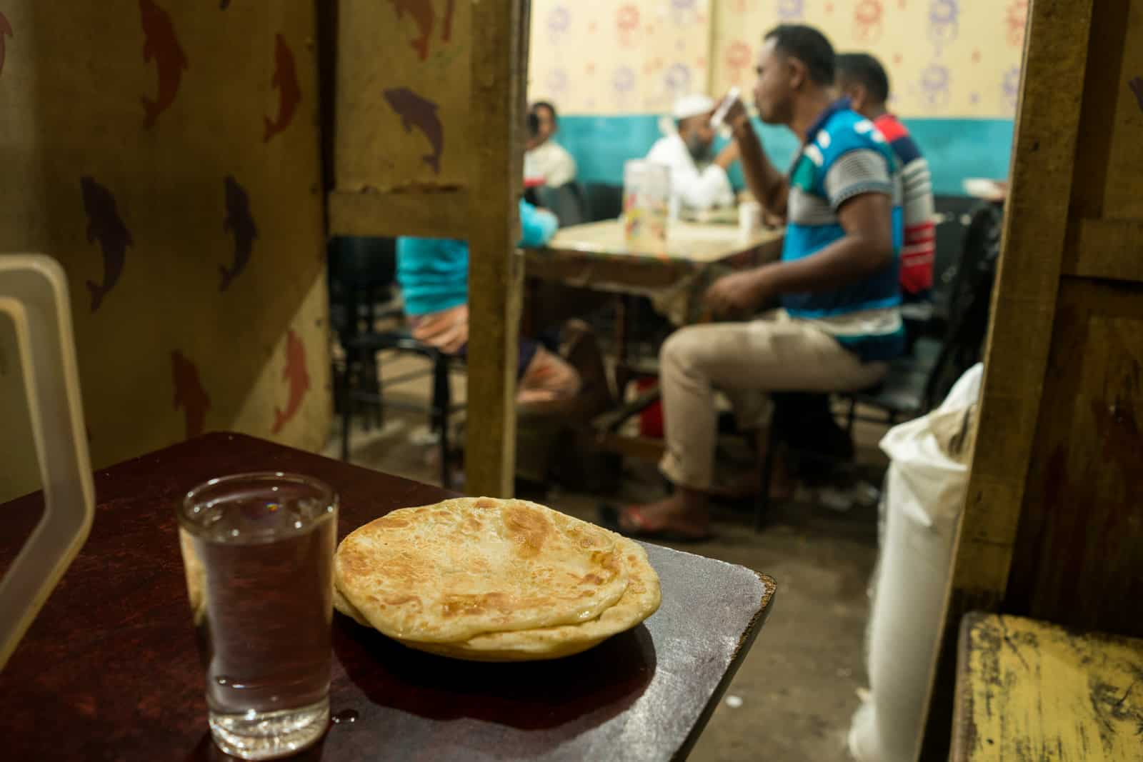 Traveling as a woman in Bangladesh - Eating dinner in a small women's seating area in a restaurant in Hatiya - Lost With Purpose travel blog