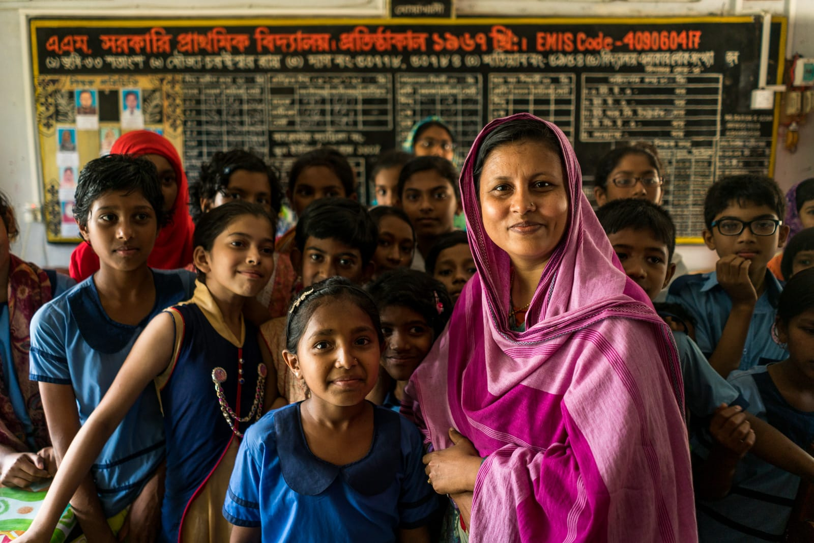 Easy ways to travel more responsibly - School teacher and girls in Hatiya, Bangladesh - Lost With Purpose travel blog